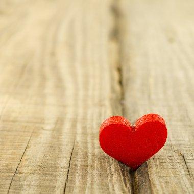 Beautiful heart on wooden table stock vector