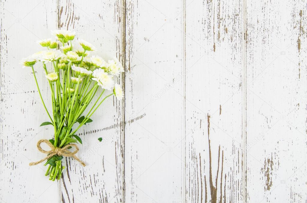 Empty wooden background with flowers