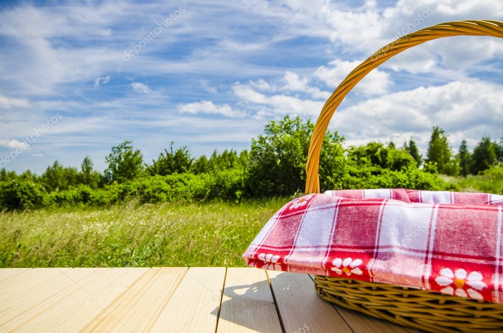 Picnic basket on wooden table