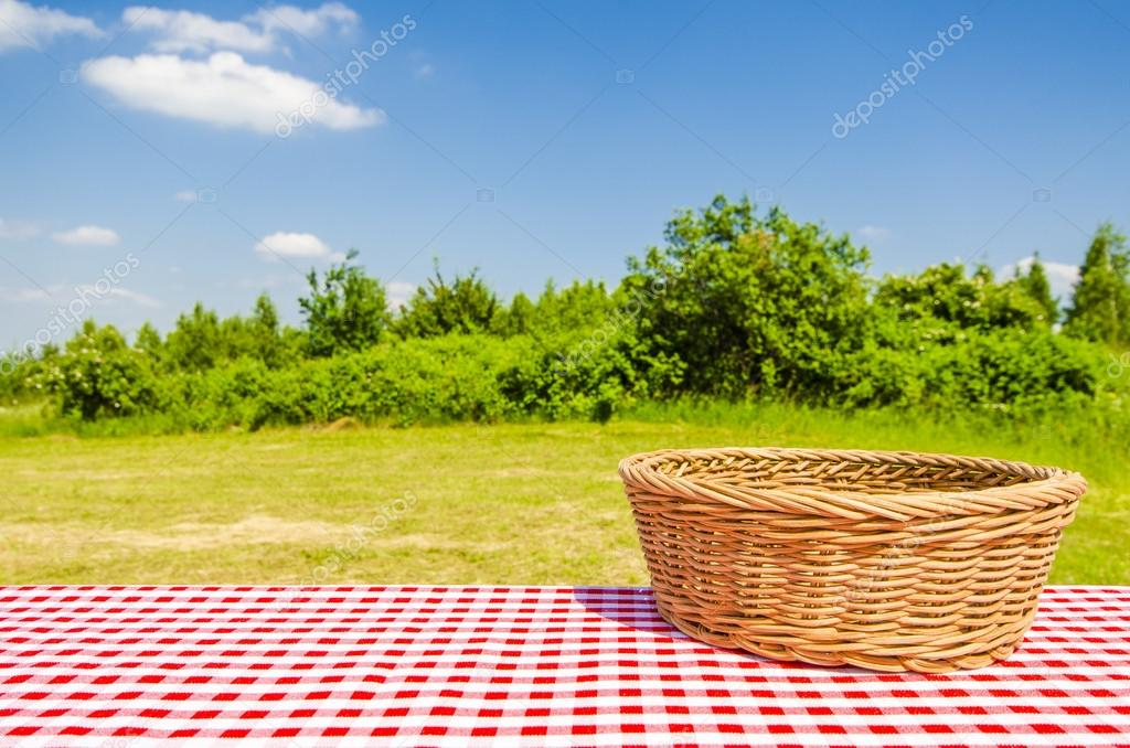 Empty table with basket and landscape background