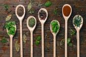 Fotografie Various spices on wooden spoons