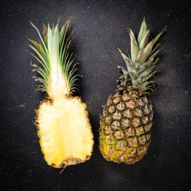 Fresh pineapple on dark background
