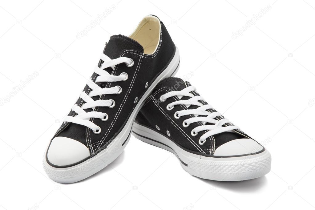 8a620fa7 Unas zapatillas sin marca de foto negras o zapatos de lona sobre fondo  blanco - fondo: sneaker — Foto de ...