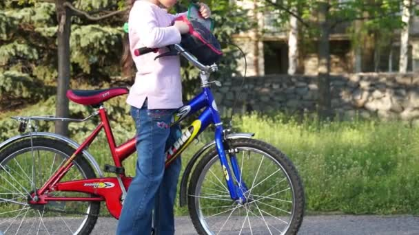 Child Rides a Bicycle to Park
