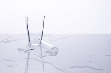 Broken glass on white table