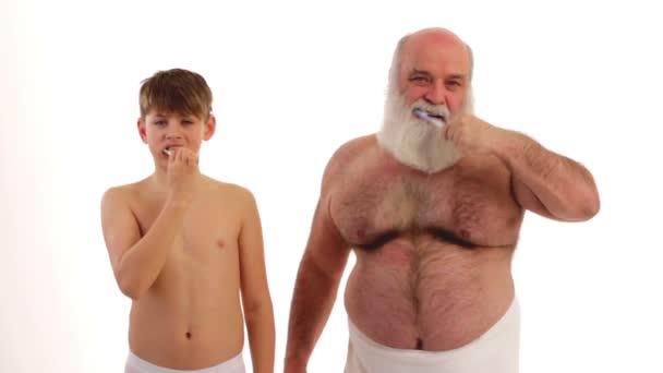 Grandpa and grandson brushing their teeth