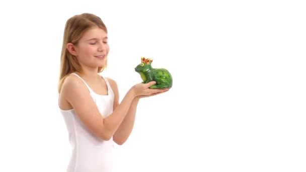 Cute girl kissing toy frog