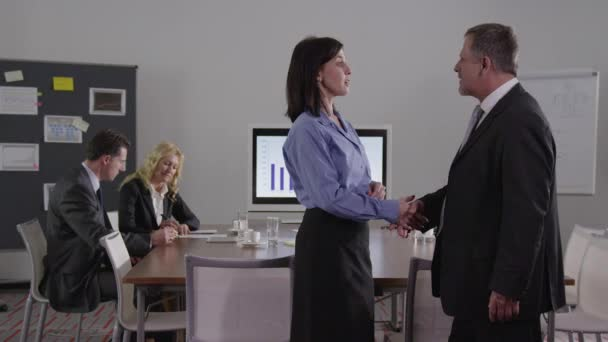 Business people - talking - shaking hands