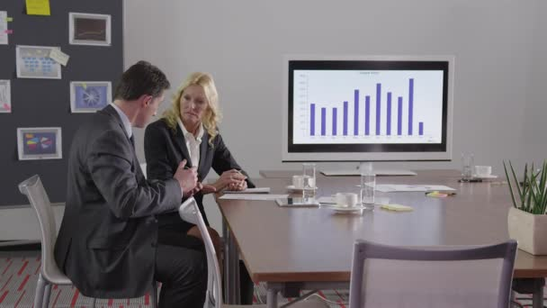 Business people - signing a contract - shaking hands - dolly shot - 4K - 2