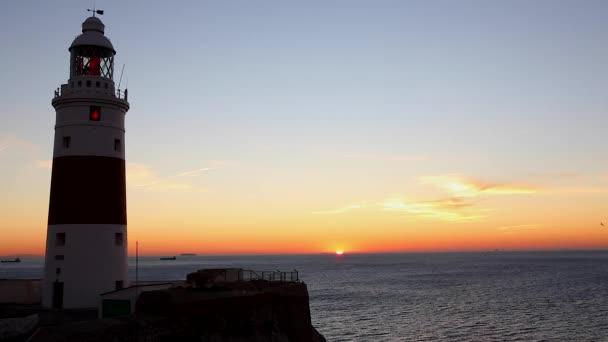 Maják - západ slunce