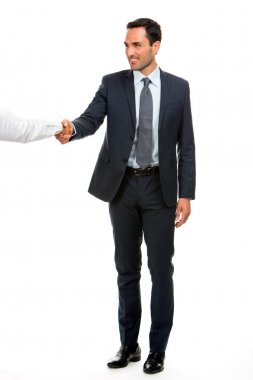 Full length portrait of a businessman smiling and shaking hand