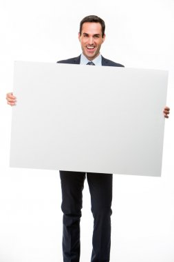 Full length portrait of a smiling businessman holding a white placard