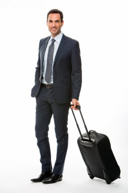 Full length portrait of a smiling businessman with trolley