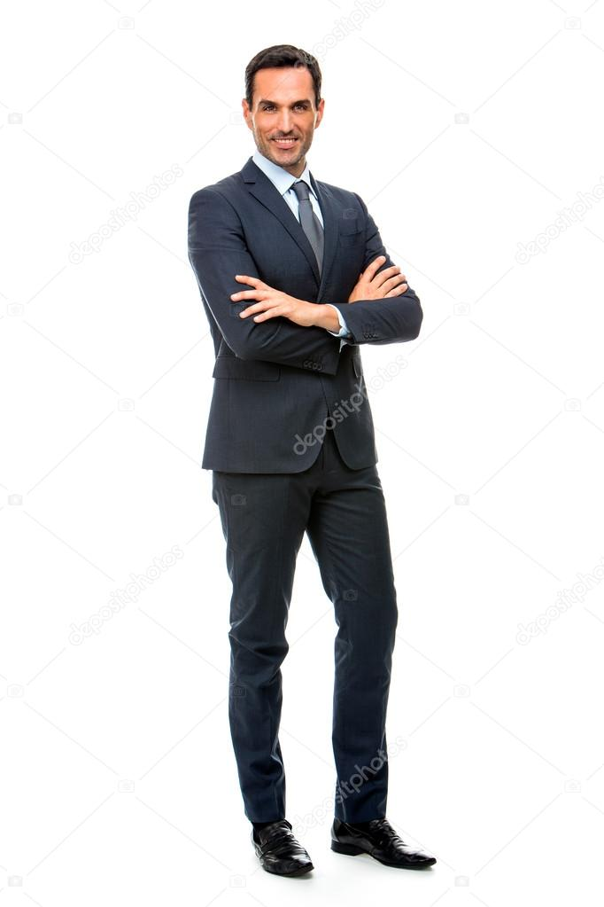 Full length portrait of a smiling businessman looking at camera with crossed arms