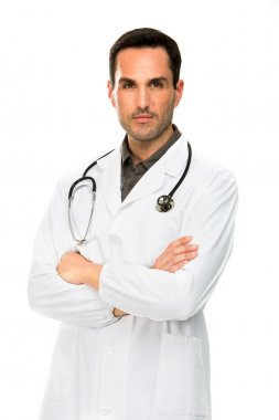 Half length portraif of a thoughtful male doctor with crossed arms and stethoscope
