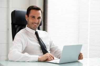 Half length portrait of a male businessman