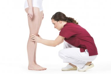 Physiotherapist doing a knee evaluation
