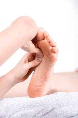 doctor reflexology to woman patient