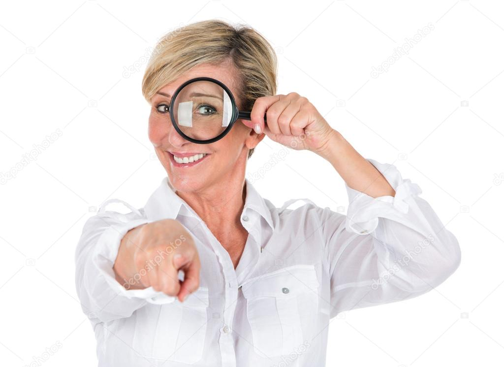 manager woman looking through magnifying glass