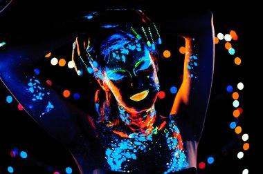 Girl with neon paint bodyart portrait