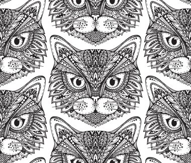 Seamless pattern with hand drawn ornate doodle cat faces.