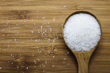 Monosodium glutamate (MSG) in wood spoon