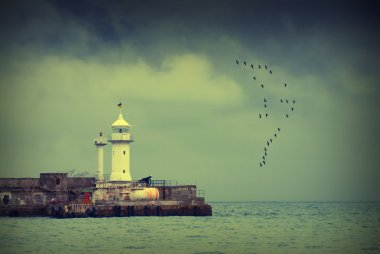 Old lighthouse in sea