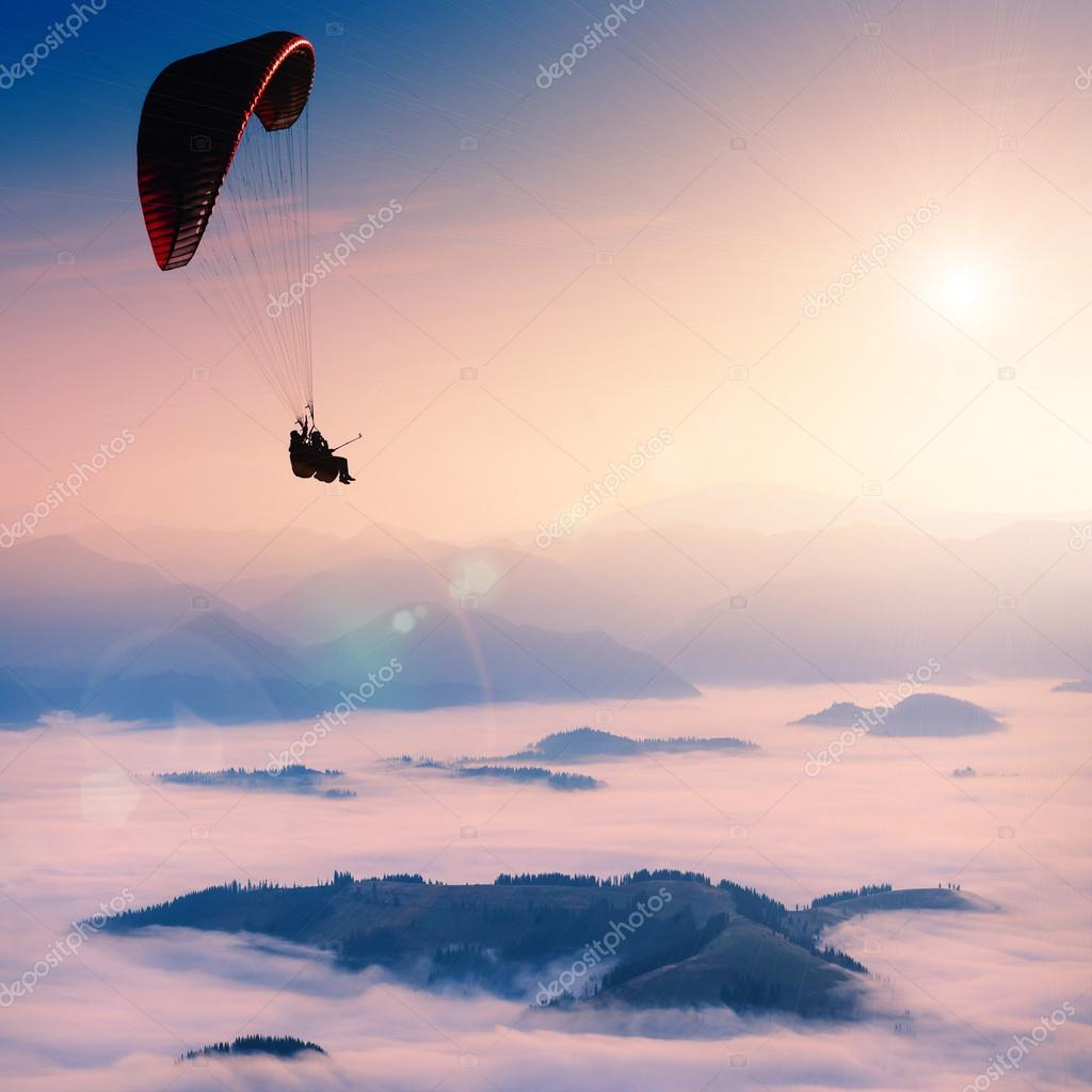 Paraglide in a morning sky