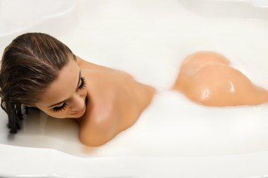 Woman enjoy bath with milk
