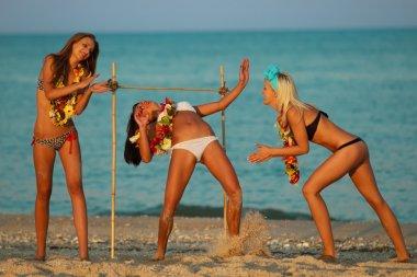 women have fun on beach
