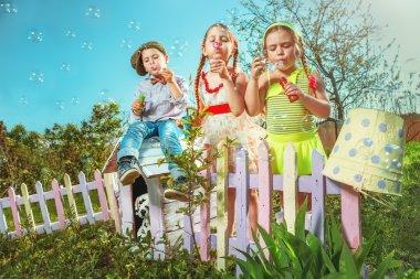 children in summer garden