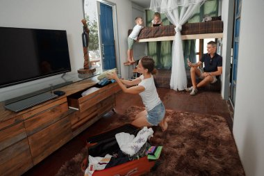 Family Arriving At Summer Vacation Rental hote