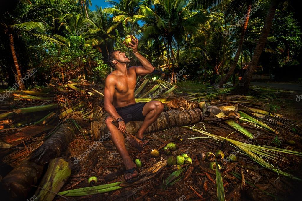 Man rinking coconu