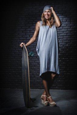 Skateboarder woman in dress