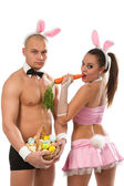 Fotografie Couple in rabbit costumes with carrot and eggs