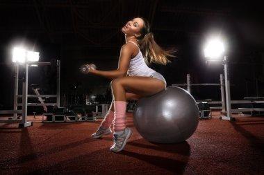 Woman exercising on Pilates ball
