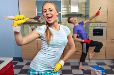 Funny couple in kitchen