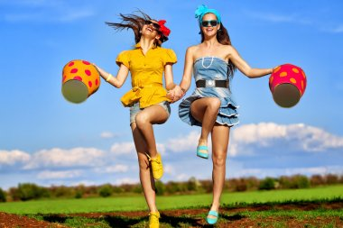 Girls jumping with  buckets