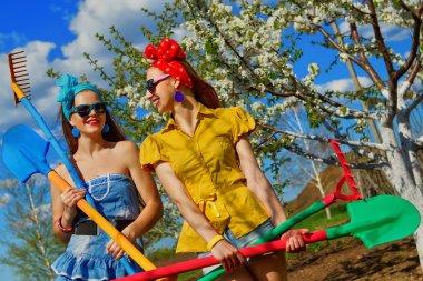 Girls working in garden
