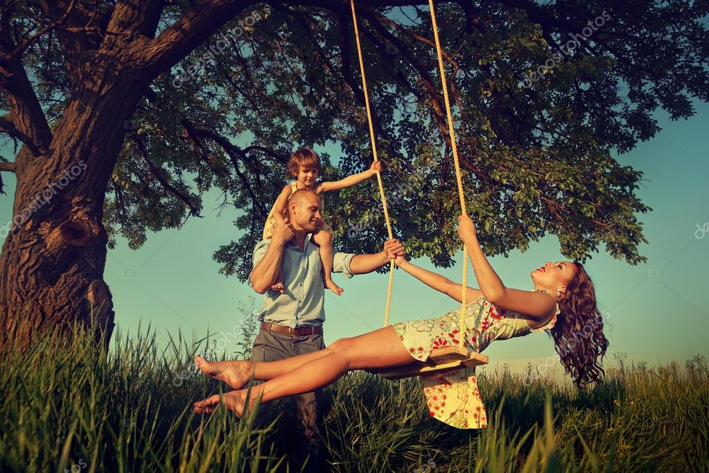 Mom with family  on  swing