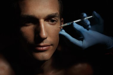 Man gets cosmetic injection.