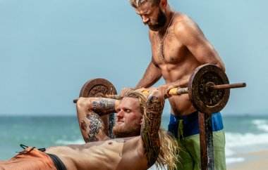 Two men doing weight lifting