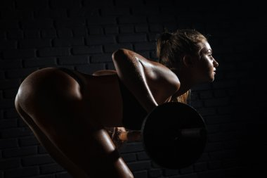 woman  doing exercises with barbell