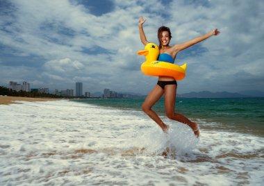 Girl with yellow lifebuoy