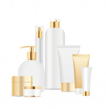 Group of white and gold cosmetic tubes.
