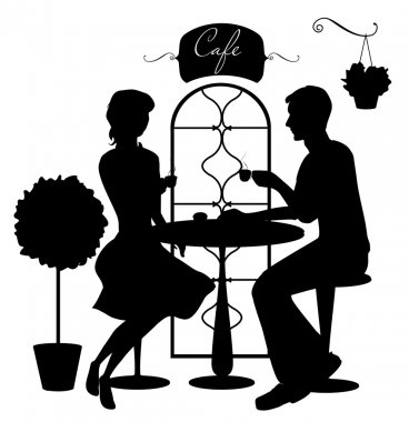 Silhouettes of couple at cafe