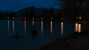 Long exposure night shot with reflections at the famous Tegernsee, Bad Wiessee, Bavaria, Germany