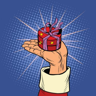Hand of Santa Claus with round gift box