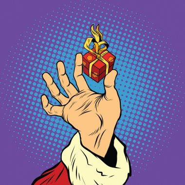 Hand of Santa Claus and a small gift