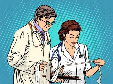 Doctor and nurse looking cardiogram pop art retro style. Medicine and health, heart disease clip art vector